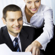 Two businesspeople, or businesswoman and client, with document a — Stock Photo #6429173