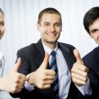 Foto Stock: Happy successful gesturing businesspeople at office