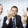 Happy successful gesturing businesspeople at office — Stock Photo #6429236