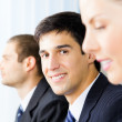 Three young successful businesspeople at office, with selective — Stock Photo