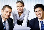 Three businesspeople working with document at office — Stock Photo