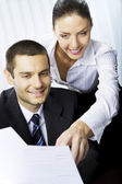 Two businesspeople, or businesswoman and client, with document a — Stock Photo