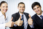 Happy successful gesturing businesspeople at office — Stok fotoğraf