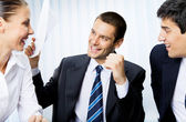 Happy successful gesturing businesspeople with document at offic — Stock Photo