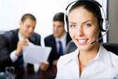 Portrait female support phone operator at workplace — Stock Photo