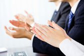 Close up clapping hands of businesspeople at presentation, meeti — Stock Photo