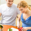 Young happy couple cooking together with vegetables at home — Stock Photo #6476967