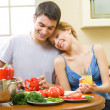 Young happy couple making salad at home together — Stock Photo #6476973