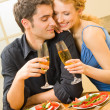 Stock Photo: Young couple celebrating with champagne at home