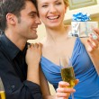 Young couple celebrating with champagne at home — Stock Photo