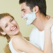 Young amorous couple having a fun together at home — Stock Photo #6477075