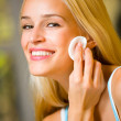 Portrait of young happy smiling beautiful woman applying creme — Stock Photo #6572030