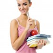 Woman with apple and notebooks — Stock Photo