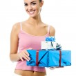 Woman with gifts over white — Stock Photo