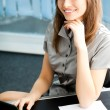 Portrait of beautiful young happy smiling business woman at offi — Stock Photo