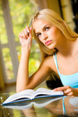Portrait of beautiful young woman with notebook or organiser, in — Stock Photo