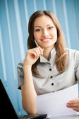 Portrait of writing happy smiling businesswoman working at offic — Stock Photo