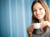 Portrait of beautiful young happy smiling businesswoman drinking — Stock Photo