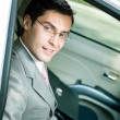 Businessman in the car - Photo
