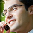 Business man working with cellphone, outdoors — Stock Photo