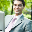 Businessman working with laptop, outdoors — Stock Photo