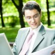 Businessman working with laptop, outdoors — Stock Photo #6584130