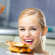 Young happy woman with pizza, indoors — Стоковое фото #6586942