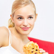 Portrait of young happy smiling woman with pie at home — Stock Photo #6587030