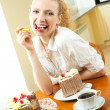 Young happy smiling beautiful young womeating torte at home — Stock Photo #6589263