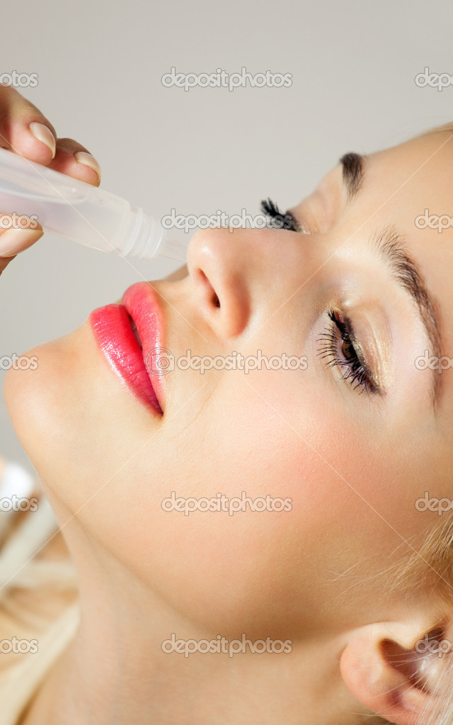 Young woman dripping nose at home — Stock Photo #6587056