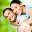 Royalty-Free Stock Photo: Portrait of young happy couple, outdoors