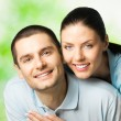 Portrait of young happy couple, outdoors — Stock Photo