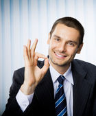 Businessman with okay hand sign at office — Stock Photo