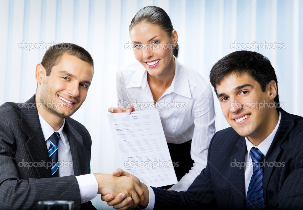 Three happy smiling successful business handshaking with document at office  Stock Photo #6653178