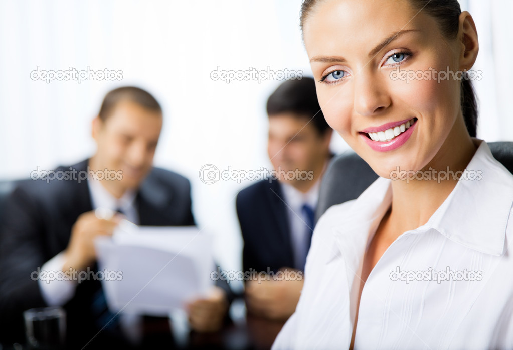 Portrait of successful young happy smiling successful business woman and colleagues on background, at office — Stock Photo #6653302