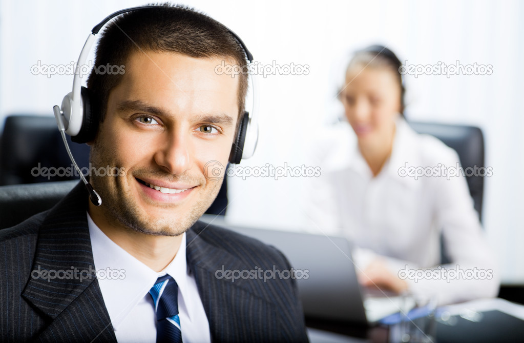 Portrait of happy smiling customer support phone operator in headset at office — Stock Photo #6653347