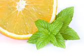 Piece of Orange with green leaf of Mint — Stock Photo