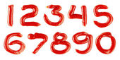 Numbers made of ketchup on white background — Stock Photo