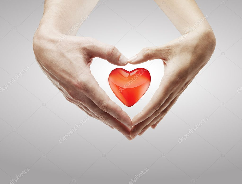 Heart shape  made of  female and male hands together.With a red heart inside.Isolated on a gray background  Stok fotoraf #6423258