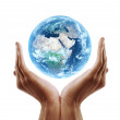 Hand holding earth - Stock Photo