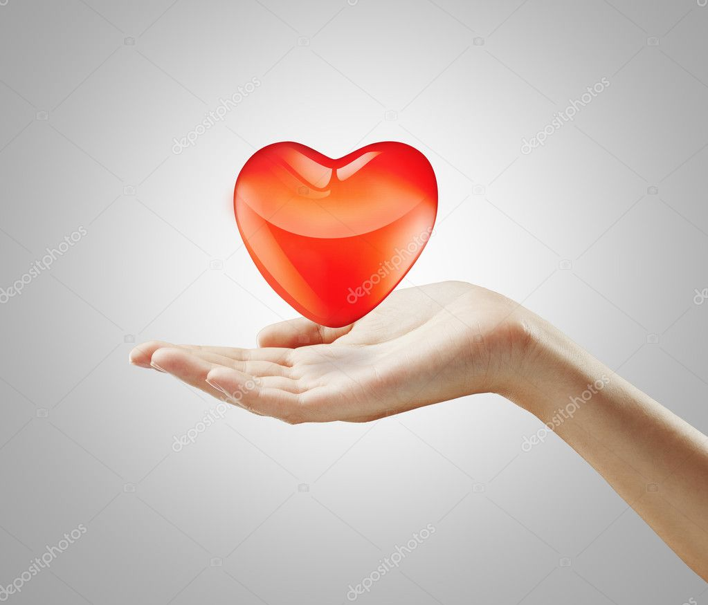 Red  heart on a woman's hand.Heart on the palm - love symbol — Stock Photo #6430299