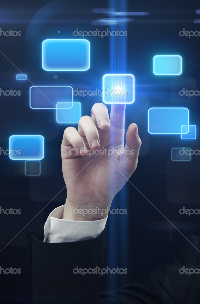 Young business man pressing a touchscreen button — Stock Photo #6430748