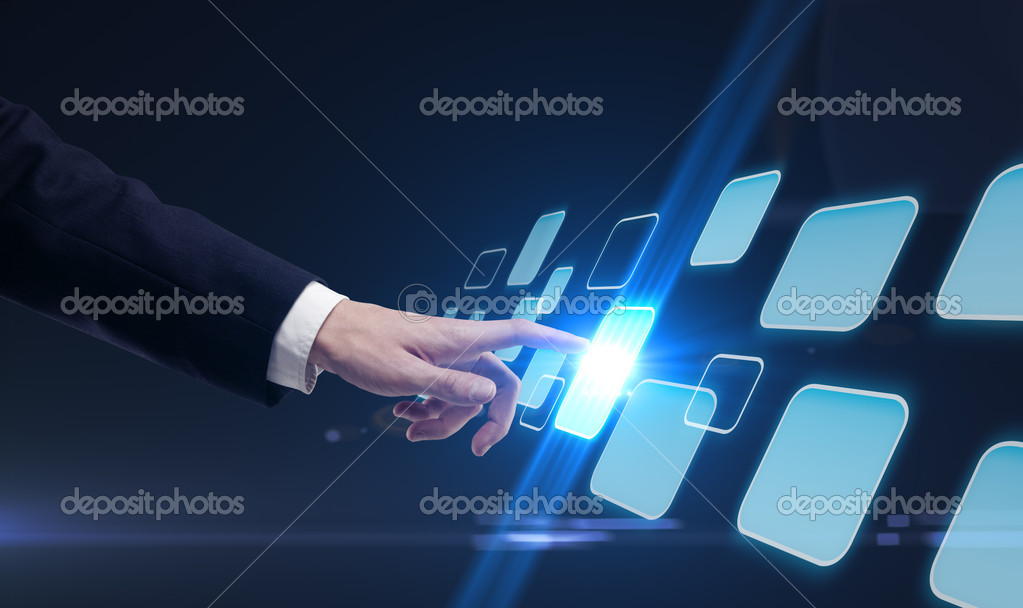 Young business man pressing a touchscreen button — Stock Photo #6430764