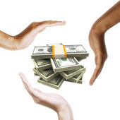 Dollar bills with multiracial human hands around it — Stock Photo