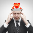 Open minded man with hearts inside thinking about the relationship - ストック写真