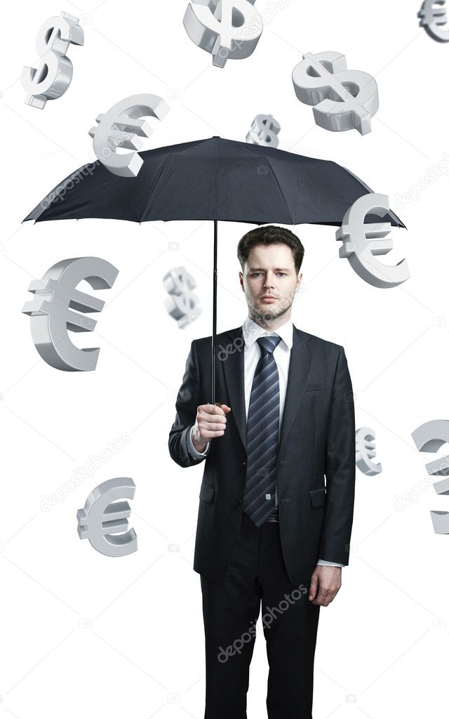 Business man with umbrella under evro and dollar signs rain. — Stock Photo #6614571