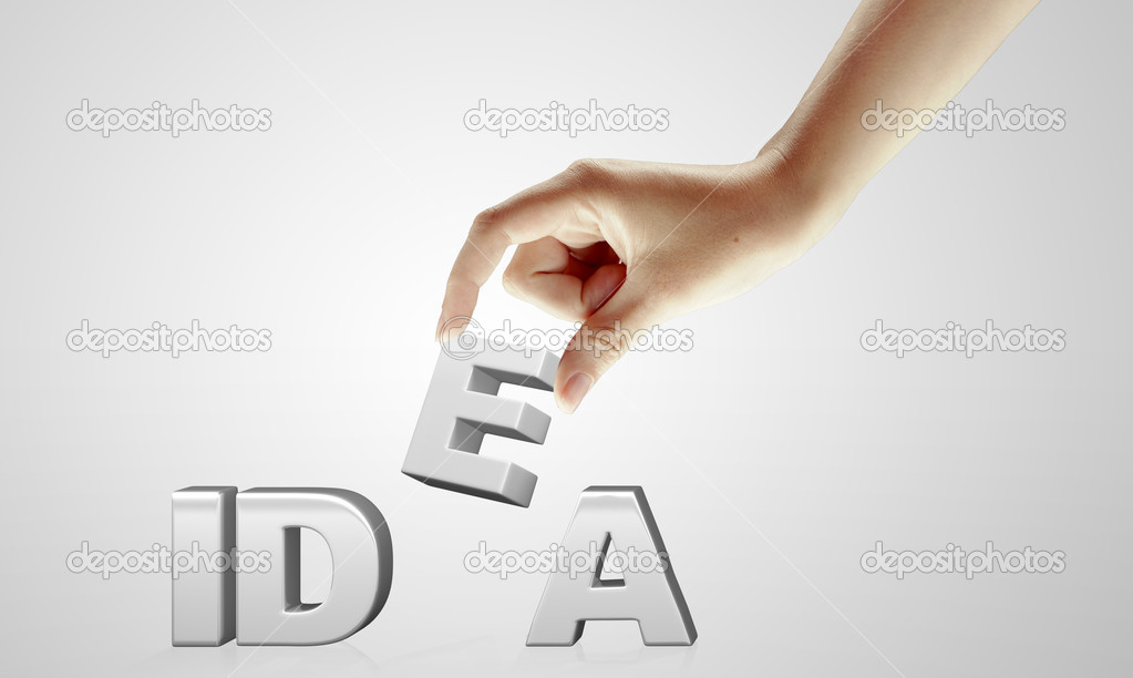 Hand and word Idea - business concept. Idea word made by female hand. On a grey background  Stock Photo #6702048