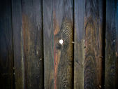 Wooden fence with spyhole — Stock Photo