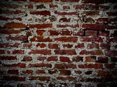 Brick wall with facing of concrete — Stock Photo