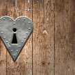 Heart keyhole on a wooden door - Stock Photo